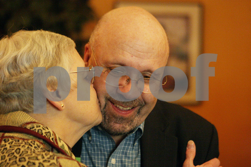 Rob Winner – rwinner@shawmedia.com<br /> <br /> John Rey receives a kiss from his wife, Marjorie, after learning of his victory in the mayoral race at Eduardo's Mexican Restaurant in DeKalb, Ill., Tuesday, April 9, 2013.
