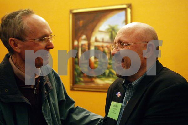 Rob Winner – rwinner@shawmedia.com<br /> <br /> Current DeKalb mayor Kris Povlsen (left) shakes hands with John Rey just before his victory to become the next DeKalb mayor at Eduardo's Mexican Restaurant in DeKalb, Ill., Tuesday, April 9, 2013.
