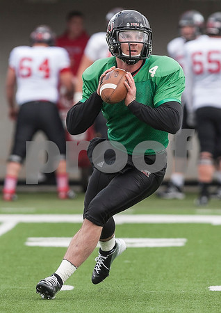 Erik Anderson - For the Daily Chronicle <br /> Northern Illinois University quarterback Jordan Lynch looks to pass during early gameplay action of the NIU spring game at Brigham Field in Huskie Stadium on Saturday, April 13, 2013.
