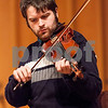 "Erik Anderson - For the Daily Chronicle <br /> Jonathon DeFranco, playing the fiddle, performs with the NIU Irish Club during the ""World Music Concert, A Musical Encounter"" at the Northern Illinois University Music Building on Sunday, April 14, 2013."
