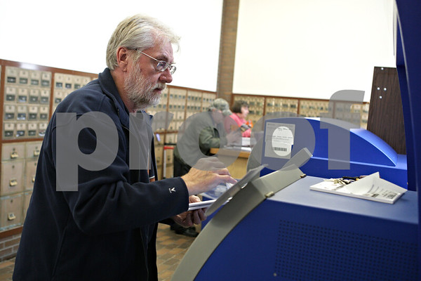 Rob Winner – rwinner@shawmedia.com<br /> <br /> DeKalb resident Steve Lux uses the Self-Service Ship and Mail Center at the DeKalb post office to pay for postage before mailing his taxes to the Internal Revenue Service on Monday, April 15, 2013.<br /> <br /> DeKalb, Ill.
