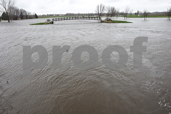 Rob Winner – rwinner@shawmedia.com<br /> <br /> A golf cart bridge over the Kishwaukee River at the River Heights Golf Course in DeKalb, Ill. is seen from Fairview Drive on the morning of Friday, April 19, 2013.