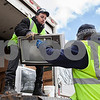 "Erik Anderson - For the Daily Chronicle <br /> Environmentally Responsible Company employees ""ERC"" Jose Orrala (left) and Shawn Fuller move a television set onto a truck for the ""E-Waste"" recycling program at the Sandwich Fairgrounds on Saturday, April 13, 2013."