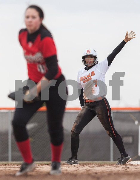 Erik Anderson - For the Daily Chronicle <br /> The Barbs short stop Jessica Townsend signals on second base to the DeKalb batter during the match up of DeKalb and Yorkville at DeKalb High School on Tuesday, April 16, 2013. Yorkville defeated DeKalb 3-2.