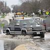 Rob Winner – rwinner@shawmedia.com<br /> <br /> A pickup truck heads west on the flooded Taylor Street near Lions Park in DeKalb, Ill., Thursday, April 18, 2013.