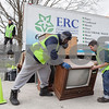"Erik Anderson - For the Daily Chronicle <br /> ""ERC"" employees Shawn Fuller (middle) and John Quinn set an oversized television set on the ground next to their truck at the Sandwich Fairgrounds on Saturday, April 13, 2013."