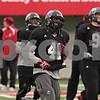 Rob Winner – rwinner@shawmedia.com<br /> <br /> Northern Illinois defensive end Perez Ford jogs with this teammates during practice at Huskie Stadium in DeKalb, Ill., Friday, April 12, 2013.