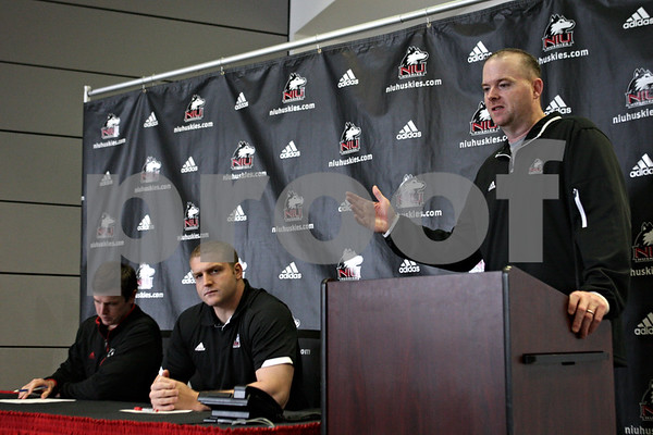 Rob Winner – rwinner@shawmedia.com<br /> <br /> Northern Illinois football coach Rod Carey (right) speaks during a press conference at the Yordon Center on the NIU campus in DeKalb, Ill., on Tuesday, April 16, 2013, ahead of Saturday's inaugural Huskie Bowl. Kevin Kane (left) will be coaching the Cardinal team and Joe Tripodi (center) the Black team.