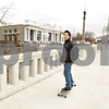 Rob Winner – rwinner@shawmedia.com<br /> <br /> Northern Illinois senior Jesse Mai rides his skateboard over the Kishwaukee River bridge on Lincoln Highway on his way to class in downtown DeKalb, Ill., Friday, April 12, 2013.