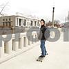 Rob Winner – rwinner@shawmedia.com<br /> <br /> Northern Illinois senior Jesse Mai rides his skateboard over the Kishwaukee River bridge on Lincoln Highway on his way to class in downtown DeKalb, Ill., Friday, April 12, 2013.