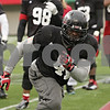 Rob Winner – rwinner@shawmedia.com<br /> <br /> Northern Illinois defensive end Perez Ford participates in a tackling drill during practice at Huskie Stadium in DeKalb, Ill., Friday, April 12, 2013.