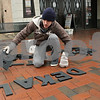 Rob Winner – rwinner@shawmedia.com<br /> <br /> Patrick Mlady, head of maintenance at the Egyptian Theatre in downtown DeKalb, lays out letters while updating the marquee on Thursday, April 11, 2013.