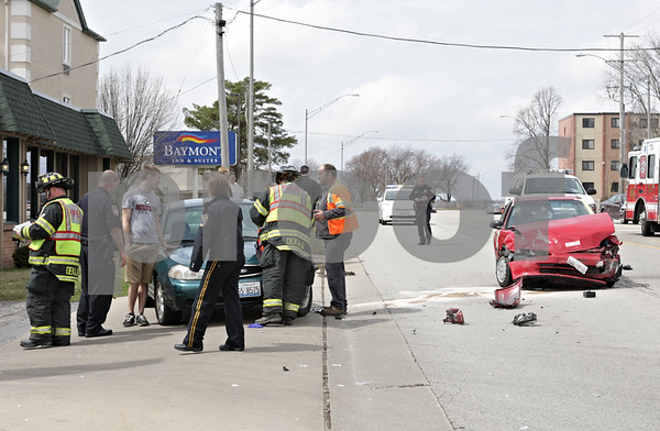 Rob Winner – rwinner@shawmedia.com<br /> <br /> Emergency personnel respond to a multi-vehicle accident near Fatty's Pub and Grille on West Lincoln Highway in DeKalb, Ill., Monday, April 15, 2013.