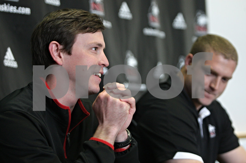 Rob Winner – rwinner@shawmedia.com<br /> <br /> Northern Illinois special teams coordinator and linebackers coach Kevin Kane (left) speaks during a press conference at the Yordon Center on the NIU campus in DeKalb, Ill., on Tuesday, April 16, 2013, ahead of Saturday's inaugural Huskie Bowl. Kane will be coaching the Cardinal team and Joe Tripodi (right), offensive line coach, will be coaching the Black team.