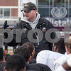 Erik Anderson - For the Daily Chronicle <br /> Huskies head coach Rod Carey speaks to his players after the spring game outside of the Yordon Center at Brigham Field in Huskie Stadium on Saturday, April 13, 2013.