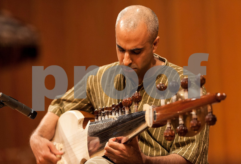 """Erik Anderson - For the Daily Chronicle <br /> Vikas Deo performs """"Alaap in Ahir Bhairiv"""" with the Sarod during the segment of """"North Indian Classical Music"""" in the """"World Music Concert, A Musical Encounter"""" at the Northern Illinois University Music Building on Sunday, April 14, 2013."""
