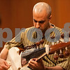 "Erik Anderson - For the Daily Chronicle <br /> Vikas Deo performs ""Alaap in Ahir Bhairiv"" with the Sarod during the segment of ""North Indian Classical Music"" in the ""World Music Concert, A Musical Encounter"" at the Northern Illinois University Music Building on Sunday, April 14, 2013."