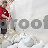 Rob Winner – rwinner@shawmedia.com<br /> <br /> Northern Illinois student Nick Karl, Phi Sigma Kappa, helps sand bag the garden apartment windows at Ashbury Court Apartments in DeKalb, Ill., Thursday, April 18, 2013.
