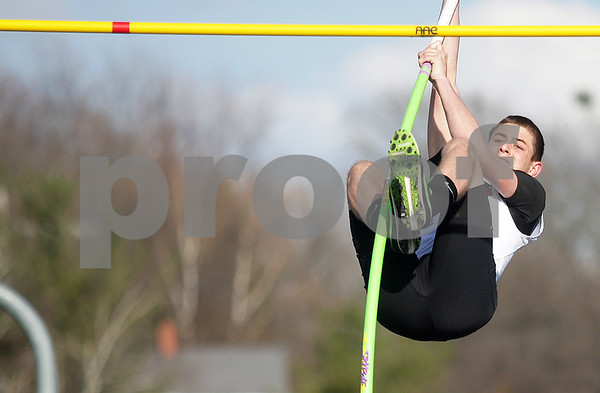 Monica Maschak - mmaschak@shawmedia.com<br /> DeKalb's Parker Dupre launches himself into the air during the pole vault event at the Sycamore Gib Seegers Classic for boys track and field on Friday, April 26, 2013.