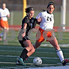 Monica Maschak - mmaschak@shawmedia.com<br /> Kaneland's Courtney Diddell and DeKalb's Rachel Torres struggle for the ball in a soccer match at DeKalb High School on Wednesday, April 24, 2013. The game ended with no score.