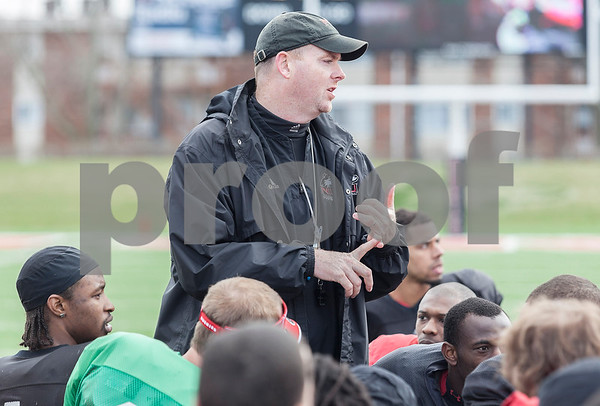 Erik Anderson - For the Daily Chronicle <br /> Northern Illinois University head coach Rod Carey speaks to his players after the game during the NIU Huskie Bowl at Huskie Stadium on Brigham Field on Saturday, April 20, 2013. The cardinal team defeated the black team.