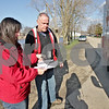 Monica Maschak - mmaschak@shawmedia.com<br /> Red Cross volunteers Tracy Lesiak and Dean Richardson look over a map of Evergreen Village in Sycamore during a second consecutive trip to hand out cleaning supplies and disaster kits to residents on Wednesday, April 24, 2013. The DeKalb County Red Cross Disaster Action Team estimated some 300 items were handed out to the residents of the approximately-160-trailer community that was recently flooded due to heavy rains last week. Among the items were trash bags, shovels, rakes, tarps and gloves. The Red Cross plans to visit the community again on Thursday to distribute water.
