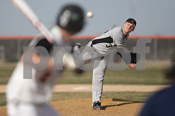 Rob Winner – rwinner@shawmedia.com<br /> <br /> Sycamore's Cole Nelson delivers a pitch to DeKalb batter Jared Johnson during the bottom of the third inning in DeKalb, Ill., Monday, April 22, 2013. Sycamore defeated DeKalb, 4-2.