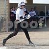 Monica Maschak - mmaschak@shawmedia.com<br /> DeKalb's Jessica Townsend swing for the ball during a game against Kaneland at DeKalb High School on Thursday, April 25, 2013. The Knights beat the Barbs 4-3.