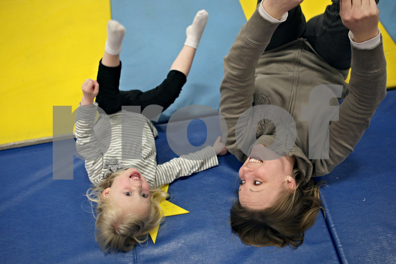 Rob Winner – rwinner@shawmedia.com<br /> <br /> Lily Beck (left), 2 of DeKalb, and her mother, Melissa, work out together during a Tumble Tots class at the Haish Gymnasium in DeKalb, Ill., Monday, April 15, 2013.