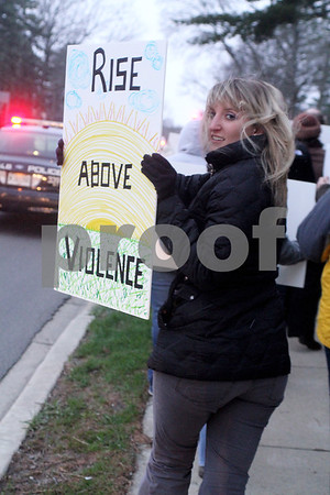 """Safe Passage Adult Domestic Violence Counselor Lanay Riley shows here support sign to drivers on 1st Street during the """"Take Back the Night"""" event against sexual violence on Friday."""