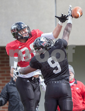 Erik Anderson - For the Daily Chronicle <br /> Northern Illinois University linebacker Rasheen Lemon (9) blocks NIU tight end Tim Semish (88) during the NIU Huskie Bowl at Huskie Stadium on Brigham Field on Saturday, April 20, 2013. The cardinal team defeated the black team.