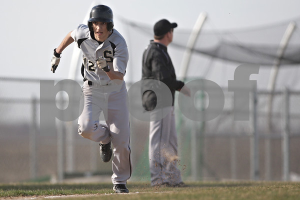 Rob Winner – rwinner@shawmedia.com<br /> <br /> Sycamore's Mark Skelley heads for the plate to score after a sacrifice fly in the top of the fourth inning in DeKalb, Ill., Monday, April 22, 2013. Sycamore defeated DeKalb, 4-2.