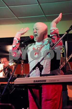 "Larry Meredith, member of the ""old fat guys"", performs for the Susan G. Komen 3-Day cancer walk in Waterman on Saturday."