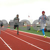 Monica Maschak - mmaschak@shawmedia.com<br /> DeKalb sophomore Dre Brown (right) leads a group of runners in a 250 meter dash during a rainy track practice on Tuesday, April 23, 2013. Brown, as well as many others, also play football in the fall.