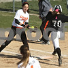 Monica Maschak - mmaschak@shawmedia.com<br /> DeKalb's Hannah Walter catches the ball to tag out Kaneland's Lexi Roach at first base during a game at DeKalb High School on Thursday, April 25, 2013. The Knights beat the Barbs 4-3.