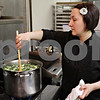 Rob Winner – rwinner@shawmedia.com<br /> <br /> Gail Roloff (left), owner of Rural Girl Soups, stirs a pot of zucchini pepper jack soup at a kitchen in Geneva, Ill., Tuesday, April 23, 2013. Orders for the soup are taken online, then prepared on Tuesday and delivered to customers in DeKalb county every Wednesday.
