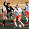 Monica Maschak - mmaschak@shawmedia.com<br /> Kaneland's Michelle Ortiz encroaches on DeKalb's Rachel Butler in a soccer match at DeKalb High School on Wednesday, April 24, 2013. The game ended with no score.