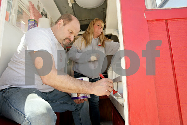 Rob Winner – rwinner@shawmedia.com<br /> <br /> On Monday afternoon in downtown Sycamore, Troy Oltman and his wife, Cassie, prepare Cassie's Popcorn Stand for their opening this coming Sunday. The stand has been owned by the family for 30 years.<br /> <br /> Monday, April 22, 2013<br /> Sycamore, Ill.
