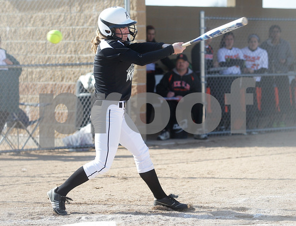 Monica Maschak - mmaschak@shawmedia.com<br /> Kaneland's Sarah Grams just misses a pitch during a game at DeKalb High School on Thursday, April 25, 2013. The Knights beat the Barbs 4-3.