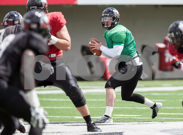 Erik Anderson - For the Daily Chronicle <br /> Northern Illinois University quarterback Jordan Lynch looks to throw during mid gameplay action at the Huskie Bowl at Huskie Stadium on Brigham Field on Saturday, April 20, 2013. The cardinal team defeated the black team.
