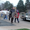"""Lisa Jensen, Director of Sexual Assault Services at Safe Passage, leads supporters down 1st Street toward downtown Dekalb during the """"Take Back the Night"""" sexual assault support walk on Friday."""
