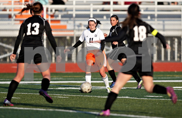Monica Maschak - mmaschak@shawmedia.com<br /> DeKalb's Julia Koca finds herself surrounded by Kaneland's defense in a soccer match at DeKalb High School on Wednesday, April 24, 2013. The game ended with no score.