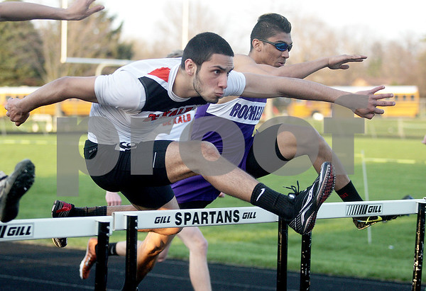 Monica Maschak - mmaschak@shawmedia.com<br /> DeKalb's Lee Parish leaps over a hurdle in the final 110 meter hurdle race at the Sycamore Gib Seegers Classic for boys track and field on Friday, April 26, 2013.
