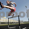 Rob Winner – rwinner@shawmedia.com<br /> <br /> Sophomore Lilia Edwards clears a hurdle during track practice at Sycamore High School on Monday, April 22, 2013.<br /> <br /> Sycamore, Ill.