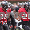 Erik Anderson - For the Daily Chronicle <br /> Northern Illinois University running back Giorgio Bowers (25) runs downfield alongside safety Jimmy Ward during the NIU Huskie Bowl at Huskie Stadium on Brigham Field on Saturday, April 20, 2013. The cardinal team defeated the black team.