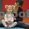 Rob Winner – rwinner@shawmedia.com<br /> <br /> DeKalb resident Jill Spyratos (right) and her daughter, Iliana Spyratos, 2, work out together during a Tumble Tots class at the Haish Gymnasium in DeKalb, Ill., Monday, April 15, 2013.