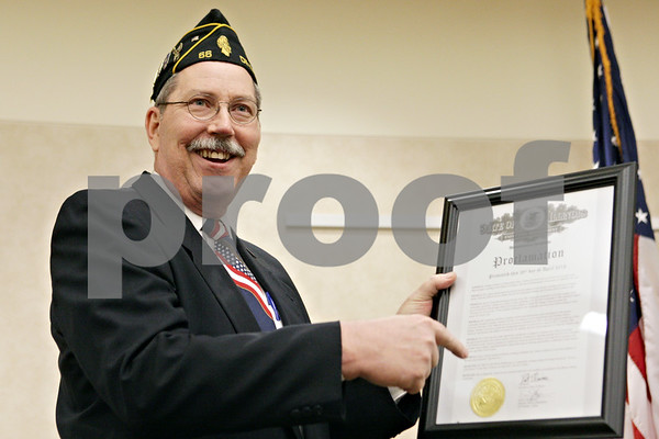 Rob Winner – rwinner@shawmedia.com<br /> <br /> U.S. Navy veteran Jonathan Lehuta, of DeKalb, reacts after being recognized as the State of Illinois' Veteran for the month of April 2013 at the DeKalb County Veterans Assistance Commission on Friday, April 26, 2013.