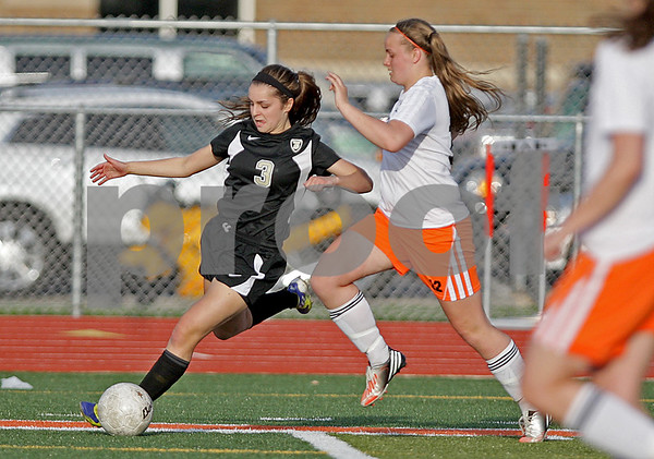 Monica Maschak - mmaschak@shawmedia.com<br /> DeKalb's Savannah Ricker runs for the ball in Sycamore's Amy Schroeder's possession during the first half of a match on Tuesday, April 30, 2013.