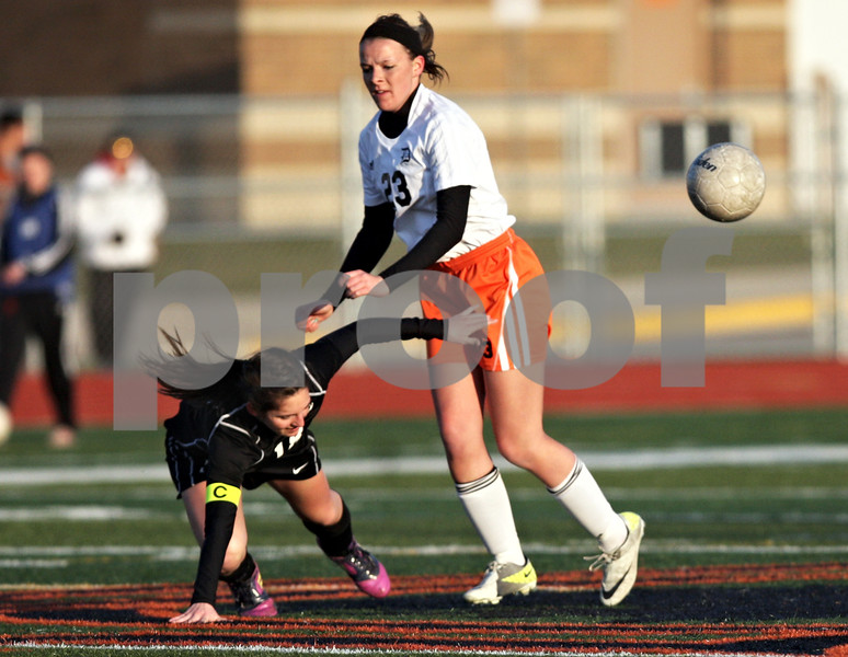 Monica Maschak - mmaschak@shawmedia.com<br /> Kaneland's Brooke Harner falls after colliding with DeKalb's Kayla Perkins in a soccer match at DeKalb High School on Wednesday, April 24, 2013. The game ended with no score.