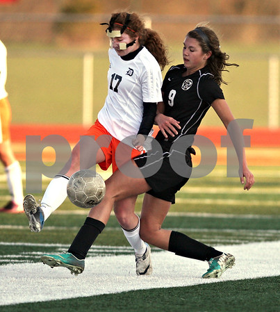 Monica Maschak - mmaschak@shawmedia.com<br /> DeKalb's Danielle Dlabal and Kaneland's Courtney Diddell stride for the ball in a soccer match at DeKalb High School on Wednesday, April 24, 2013. The game ended with no score.
